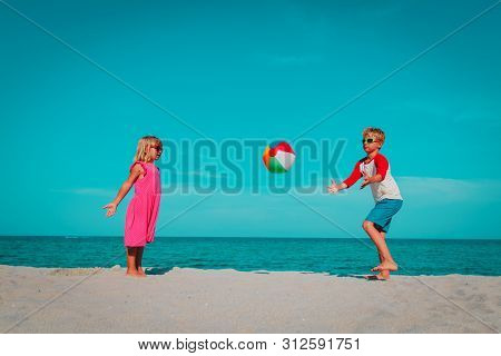 Kids Play With Ball On Beach, Boy And Girl Have Fun At Sea
