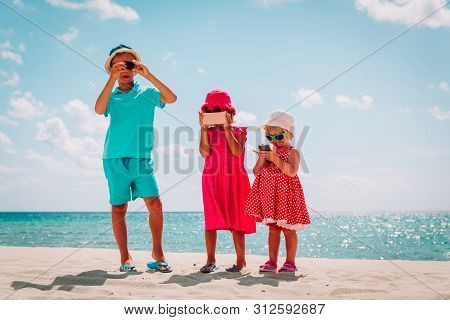 Kids Making Photo Or Video With Mobile Phone And Camera On Beach