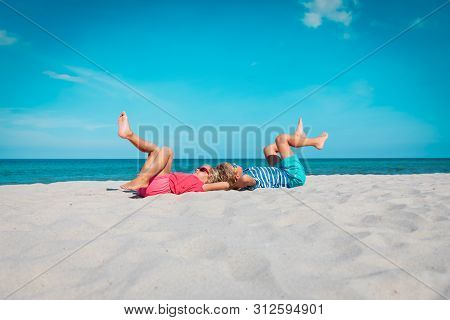 Little Boy And Girl Play On Tropical Beach