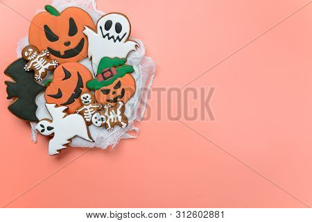 The Hand-made Eatable Gingerbread Halloween Pumpkin, Ghosts, Bat And Sceletons On Pink Background