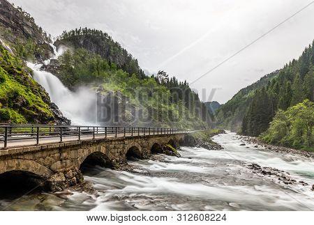 Latefoss Waterfalls Streams Under The Stone Bridge Archs, Odda, Hordaland County, Norway
