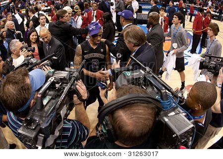 LOS ANGELES - MARCH 12: Washington Huskies G Isaiah Thomas #2 gets interviewed by CBS after the NCAA Pac-10 Tournament basketball championship game on March 12 2011 at Staples Center in Los Angeles, CA.