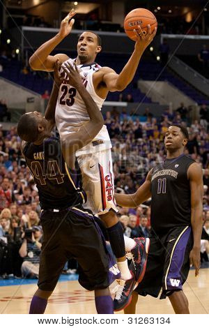 LOS ANGELES - MARCH 12: Arizona Wildcats F Derrick Williams #23 & Washington Huskies F Darnell Gant #44 during the NCAA Pac-10 Tournament basketball championship game between on March 12 2011 in Los Angeles, CA.