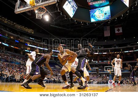 LOS ANGELES - MARCH 12: Arizona Wildcats F Derrick Williams #23 covers up and holds on to a rebound during the NCAA Pac-10 Tournament basketball championship game on March 12 2011 at Staples Center in Los Angeles, CA.