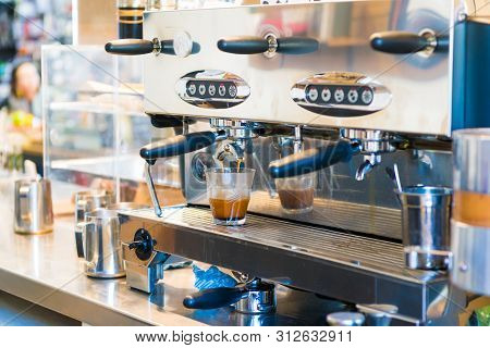 Close-up Of Espresso Coffee Machine. Professional Coffee Brewing