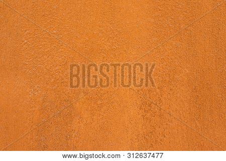 Traditional Moroccan Terracotta Colored Background. Orange Or Ocher Clay Wall Texture. Painted Shabb