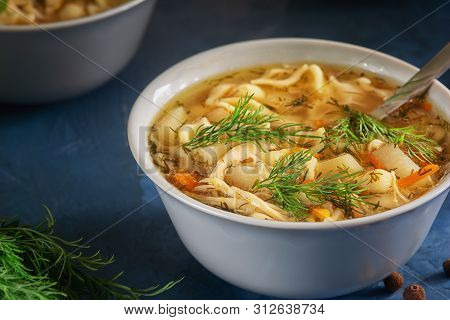 Fresh Cooked Chicken Noodle Soup In Bowl Closeup. Full Dish Of Tasty Meat Broth With Pasta And Veget