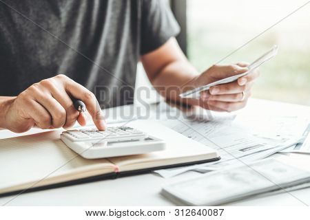 Man Using Calculator Accounting Calculating Cost Economic Bills With Money Stack Step Growing Growth