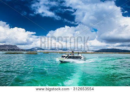 Titicaca, Peru- Jan 5, 2019: Traveling by boat at Titicaca lake near Puno, Peru, South America.