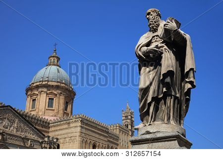 Statue Of Patron Saint Ambrosius In Front Of Palermo Cathedral. Sicily. Italy