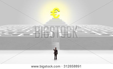 Man standing in front of a big round maze with profit concept on the middle