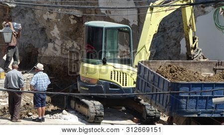 Excavating Site Of Newly Demolished Residential Building