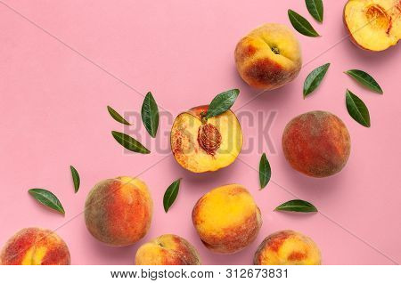Flat Lay Composition With Peaches. Ripe Juicy Peaches With Green Leaves On Pink Background. Flat Lay