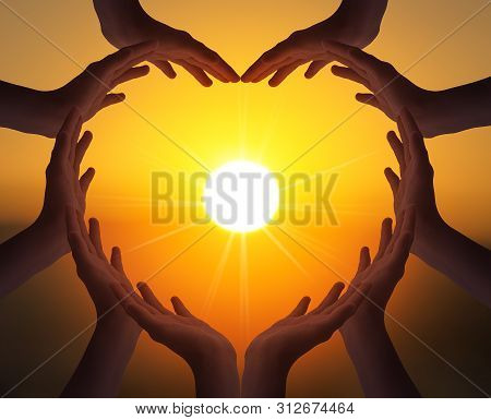 International Day Of Friendship Concept:  Many People Hands In Shape Of Heart On Blurred Beautiful