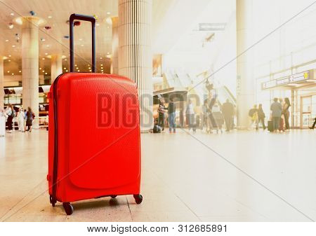 Suitcase In Airport Airport Terminal Waiting Area With Lounge Zone As A Background. Traveling Luggag