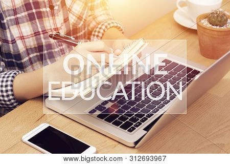 Online Learning Course Concept. Student Using Computer Laptop For Training Online And Writing Lectur