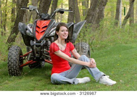 Woman Sitting With Atv