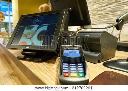COLOGNE, GERMANY - CIRCA OCTOBER, 2018: payment terminal and cash register in Oil & Vinegar store in Cologne.