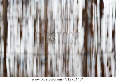 Vertical Sticks Through Which The Light Shines, Create A Blurred Abstract Background