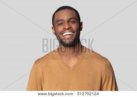 Headshot Portrait Of Black Man Posing In Studio