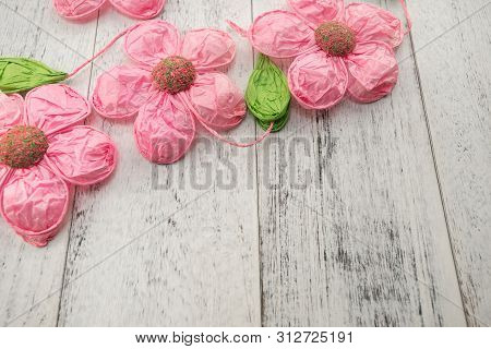Artificial Pink Paper Flowers On White Wooden Background, Selective Focus. Decoration For Interior A