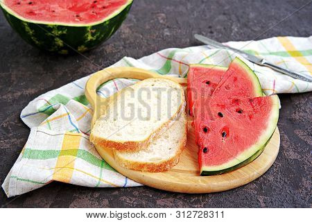Snack Or Lunch, Sliced Ripe Watermelon And Wheat Bread On A Wooden Board On A Dark Brown Background.
