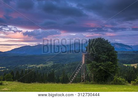 Hunting Tower In The Mountains During A Spectacular Sunrise After A Night Storm
