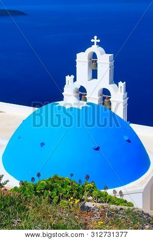 Santorini, Greece Iconic View Of Blue And White Church Dome And Sea Panorama