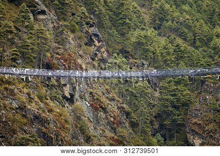 The Famous Hillary Suspension Bridge Between Monjo And Namche Bazaar, Everest Region, Nepal, Sagarma