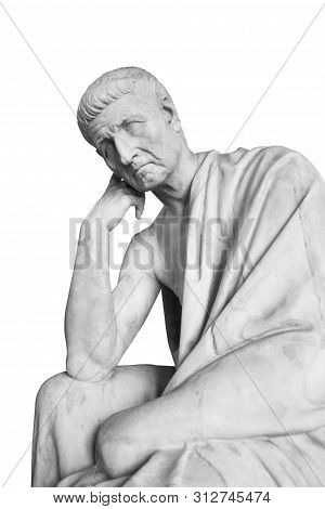 Closeup Front View Marble Statue Of Old Man With Robe On Shoulders Holding His Chin On Fist In Think
