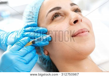 The Beautician Makes Professional Rejuvenation Vitamin Injections For The Skin Of The Patient's Face