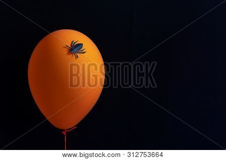 Scary Air Balloons With Paper Spider For Halloween Over Black Background