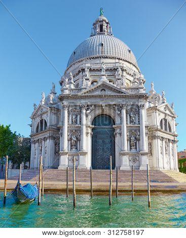 Basilica Santa Maria Della Salute On Embankment Of Canal Grande In Venice, Italy