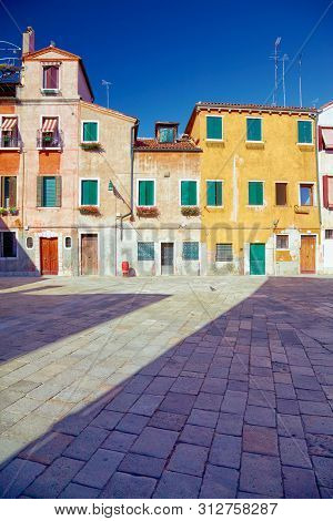 Traditional Venetian Houses And Yard Under Blue Sky, Venice, Italy
