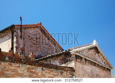 Murano Old Buildings On Blue Sky Background, Veneto, Italy