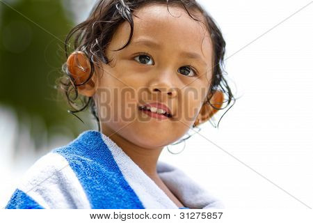 Cute Child In Towel Blanket After Swimming