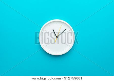 Clock With Yellow Second Hand Hanging On The Wall. Minimalist Flat Lay Image Of Plastic Wall Clock.