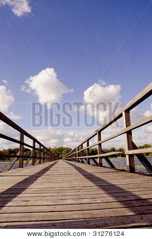 Long Walk Wooden Sirvenos Lake Bridge In Astravas
