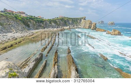 Cantabrian coastline landscape in costa quebrada, Arnia Beach, Coast of Liencres Cantabria, Spain