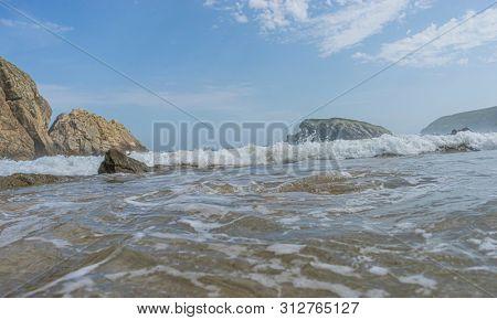 Travel, Cantabrian coastline landscape in costa quebrada, Arnia Beach, Coast of Liencres Cantabria, Spain