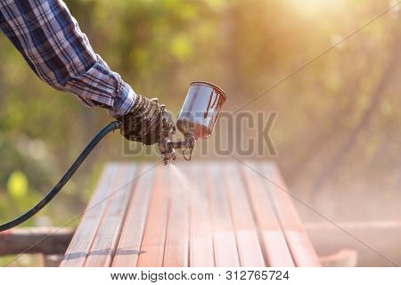 Worker Spraying Paint To Steel Pipe To Prevent The Rust On The Surface
