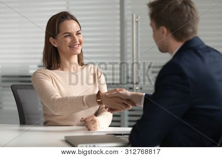 Happy Female Job Applicant Get Hired Employed At Job Interview