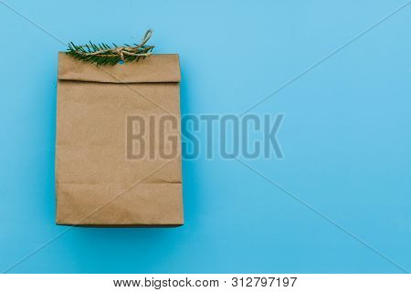 Empty Carton Pack With Spruce Branch. Brown Package For Gift Or Fast Food. Paper Bag For Storing Foo