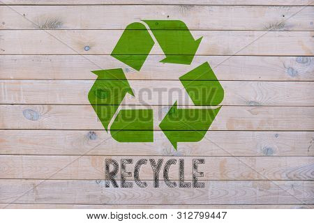 Recycling Symbol. Eco Recycling. Eco Concept With Recycle Symbol On Wooden Table Background. Keeping