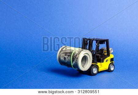 Forklift Truck Carries A Bundle Of Dollars. Attracting Direct Investment In Business And Production,