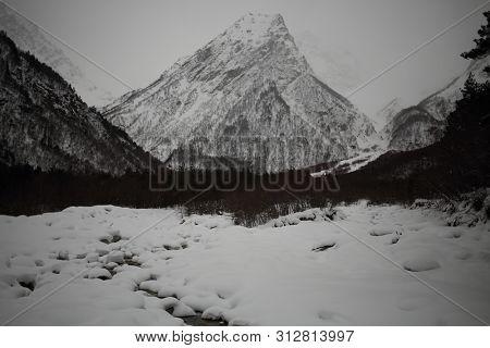 Winter mountain peaks in fog