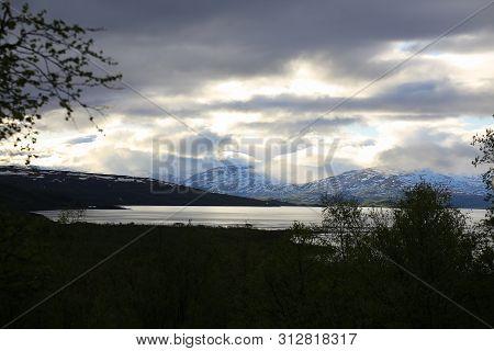 Fantastic Cloud Formations Over Lake Tornetrask In Sweden.