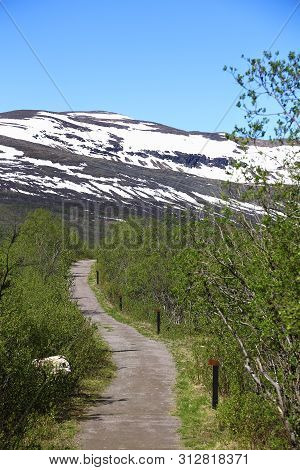 Road Leading To Mount Nuolja At Abisko In Sweden.