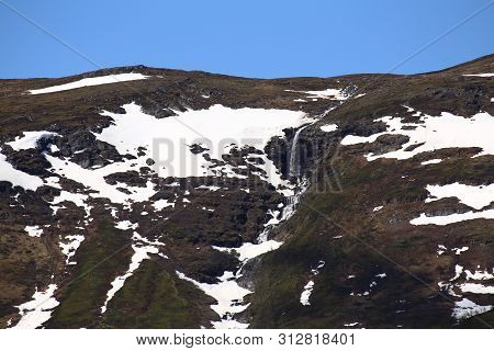 Waterfall At Mount Nuolja In Northern Sweden.