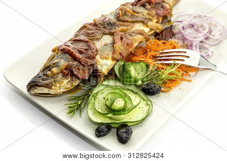 Seafood. One, Big, Baked European Bass (dicentrarchus Labrax) With Vegetables On A Plate Close-up, O